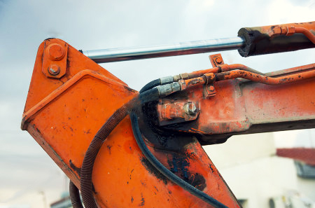 stock-photo-portion-of-the-hydraulic-system-of-an-excavator-209111176